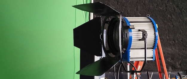 Studio light equipments for photo or film movie video. light set for professional shooting and screen background. led flood light and spot light for video production. setup include barn door softbox.