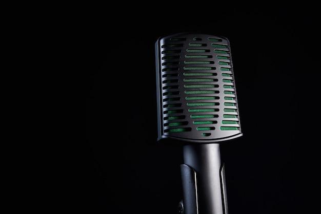 Studio microphone on black background