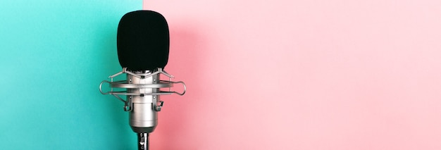 Studio microphone on blue pink