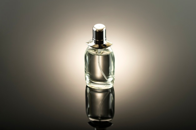 Studio photo, perfume bottle on a dark surface without a name
