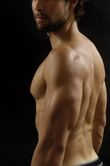 Studio photography of a man with his back