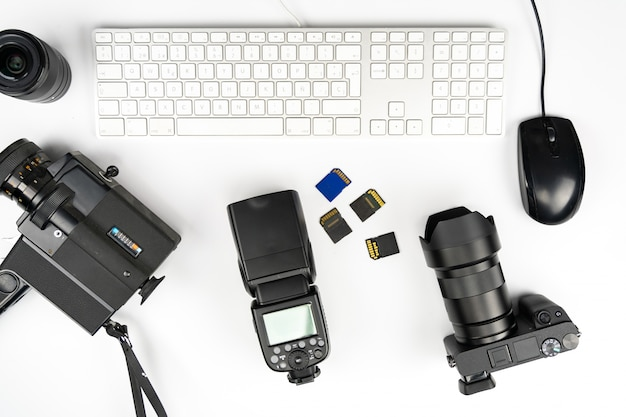 Studio photography with computers, cameras, flashes and multiple lens
