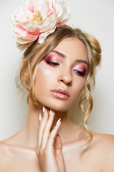 Studio portrait of a beautiful girl with makeup