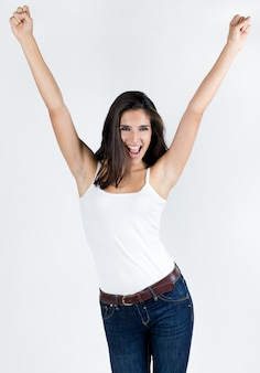 Studio portrait of beautiful young woman posing with white screen Free Photo