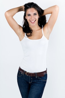 Studio portrait of beautiful young woman posing with white screen