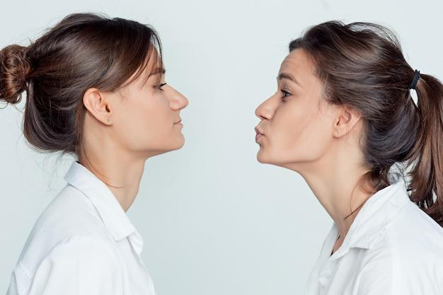 Studio portrait of female twins