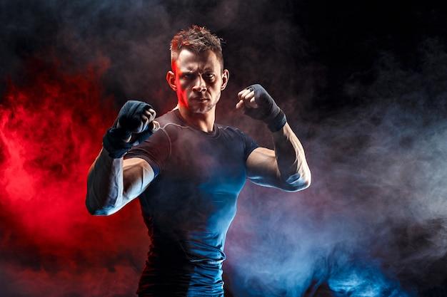 Studio portrait of fighting muscular man