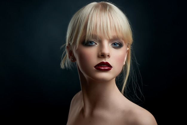 Studio portrait of a girl with evening make up.