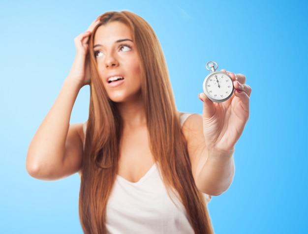 Studio portrait of girl with timekeeper