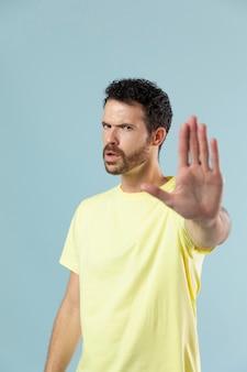 Studio portrait of man in yellow t-shirt