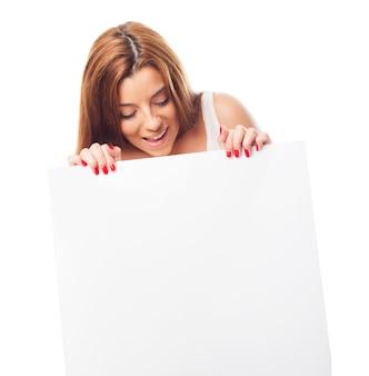 Studio portrait of girl holding white blank
