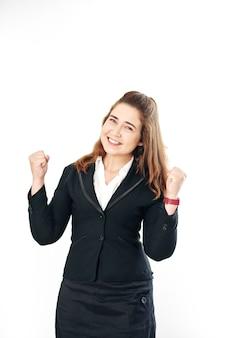 成功または勝利を祝い、拳バンプを作る幸せな若い実業家のスタジオポートレート