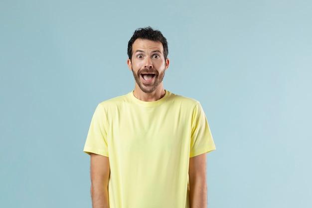 Studio portrait of surprised young man