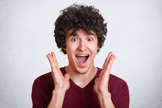 Studio shot of attractive man with dark curly hair