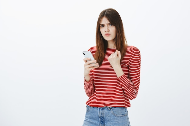 Studio shot of a brunette girl in casual outfit