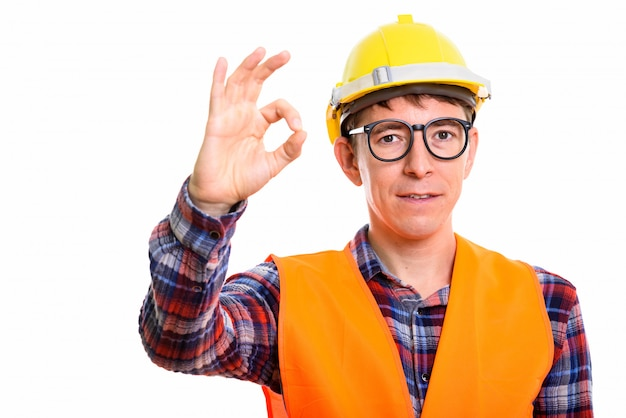 Studio shot of caucasian man constructon worker standing isolated against white background