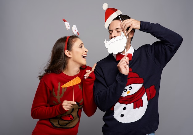 Studio shot of couple with funny christmas gadgets