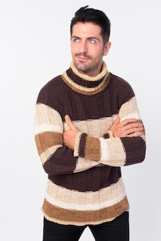 Studio shot of handsome bearded man ready for winter isolated against white background