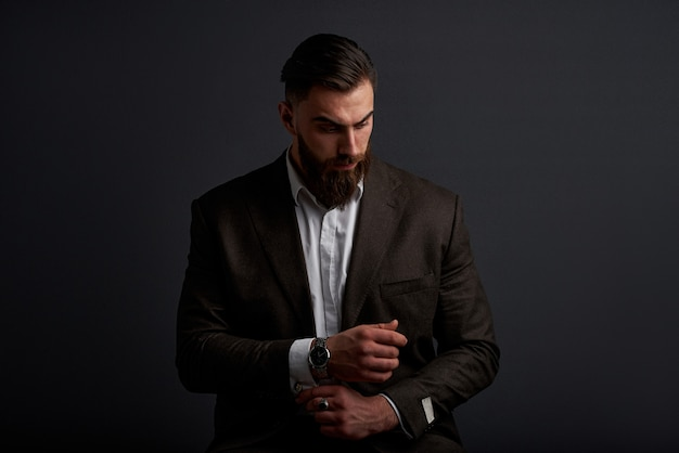 Studio shot of handsome businessman against black space