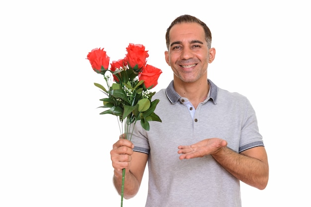 Studio shot of mature handsome persian man isolated against white background