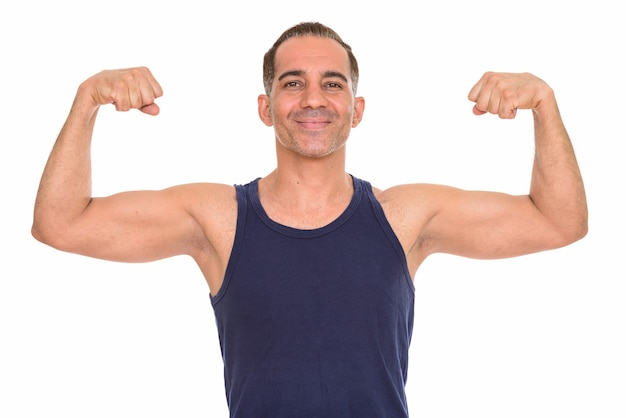Studio shot of mature handsome persian man ready for gym isolated against white background