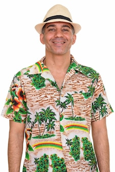 Studio shot of mature handsome persian tourist man isolated against white background