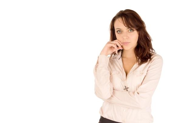 白い背景の上の魅力的な若い女性のスタジオショット