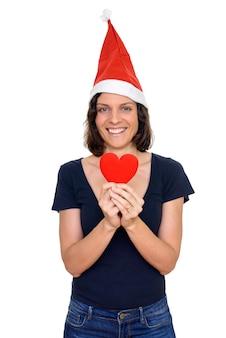 白い背景に対して隔離のクリスマスの準備ができて短い髪の美しい女性のスタジオショット