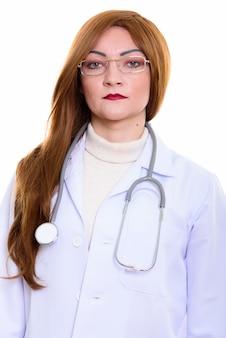 Studio shot of woman doctor wearing eyeglasses isolated against white background