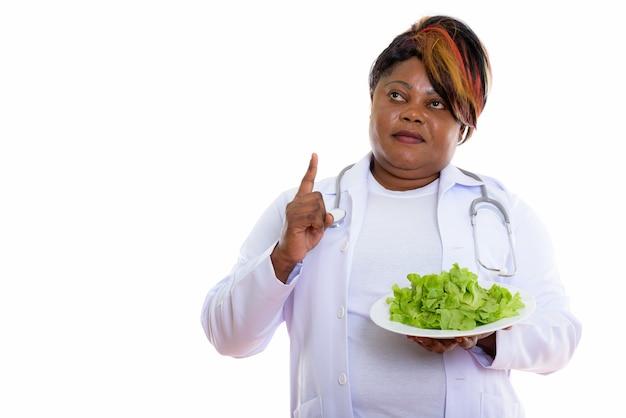 Studio shot of woman doctor