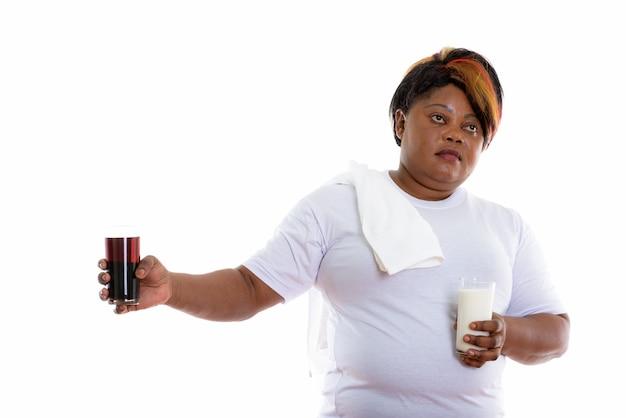 Studio shot of woman holding glass of milk