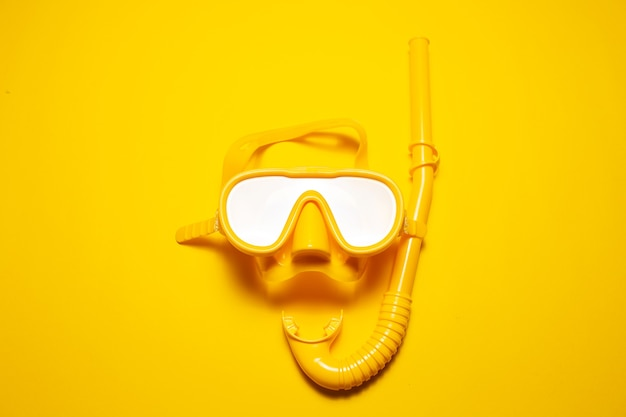 Studio shot yellow diving mask with snorkel, part of dive equipment isolated