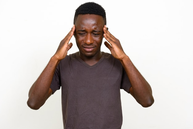Studio shot of young african man isolated against white background