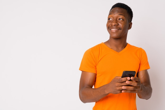 Studio shot of young handsome african man with afro hair against white background