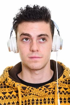 Studio shot of young handsome man isolated against white background