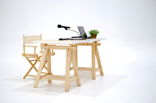 Studio wood table with laptop and microphone