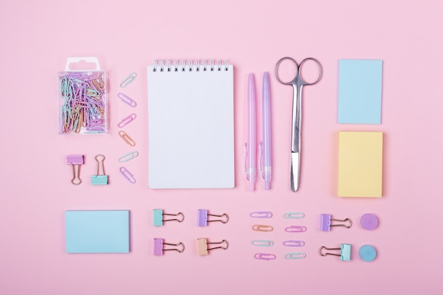 Study and back to school accessories on pink