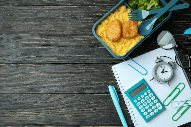 Study concept with lunch box on wooden table