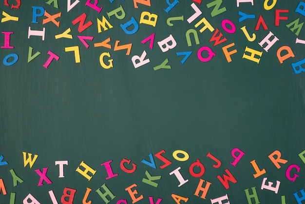 Studying english language at school concept. top above overhead view photo of colorful letters with blank center isolated on greenboard