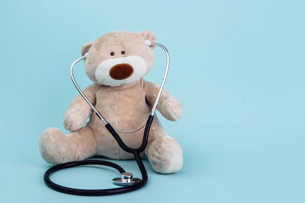 Stuffed bear animal presented as a pediatrician holding a stethoscope