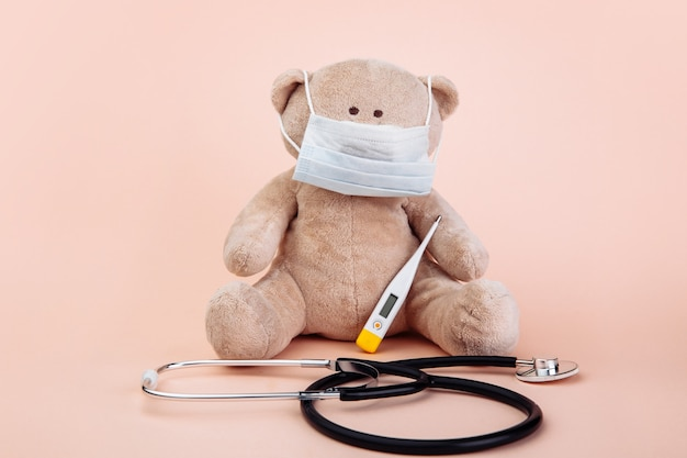 Stuffed bear animal presented as a pediatrician with doctor's tools
