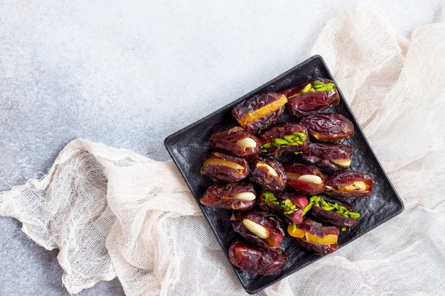 Stuffed dates with nuts and candied fruit filling