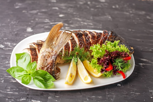 Stuffed fish with herbs and lemon. the concept of food and resta