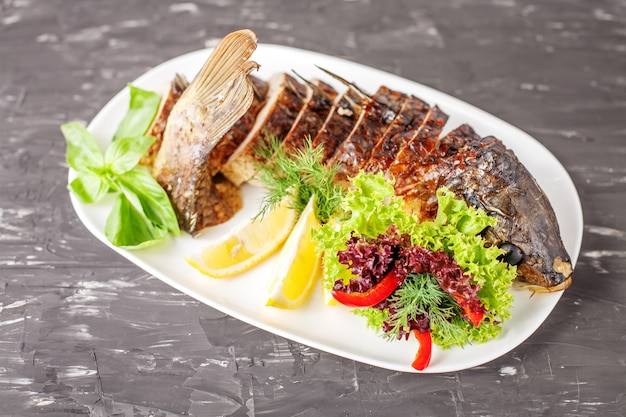 Stuffed fish with herbs, pepper and lemon. the concept of food a