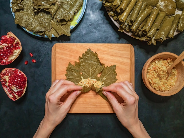 Stuffed grape leaves. preparation of dolma from grape leaves.