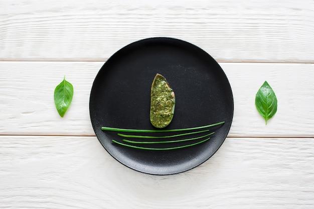 Stuffed mussel on black plate