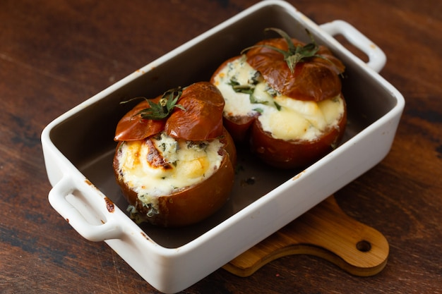 Stuffed tomatoes with cream cheese, cottage cheese and basil