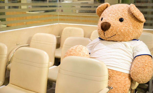 A stuffed toy bear at the waiting area