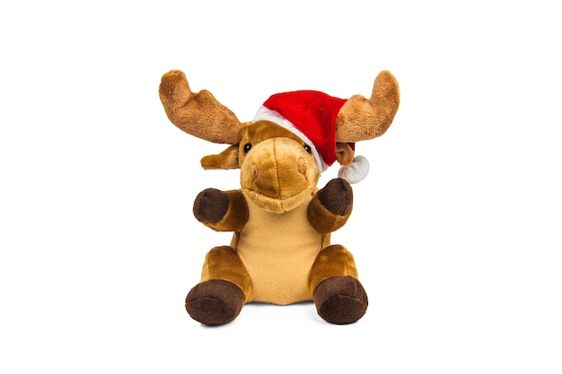 Stuffed toy christmas deer in santa claus hat isolated on white wall