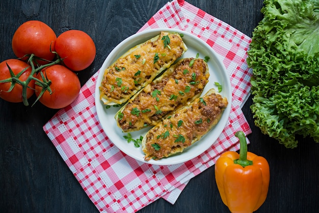 Stuffed zucchini with minced meat and grated cheese